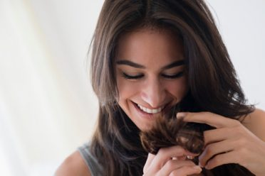 Close up of woman admiring her hair