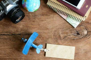 Outfit of traveler on wooden background and copy space, Vintage tone, Travel concept